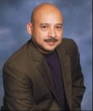 Rev. Sam Flores District Superintendent